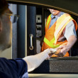 Mpaying money at toll booth — Stock Photo #5107652
