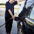 Man pumping gasoline — Stock Photo