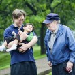 Three generations interacting together — Stock Photo