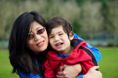 Asian mother and son together at park — Stok fotoğraf