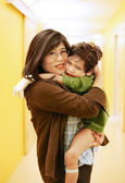 Mother holding son in hospital — Stock Photo