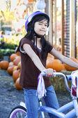 Little girl with bike helmet on bicycle — Stock Photo