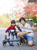 Teen boy with disabled little brother — Foto de Stock