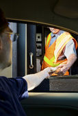 Man paying money at toll booth — Stock Photo