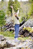 Girl raising hands in praise — Stock Photo