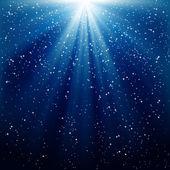 Neige et étoiles tombent sur le fond de ra lumineux bleu — Vecteur