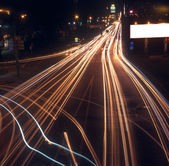 Motion blur of car lights on street at night. — Stock Photo