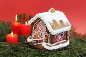 Christmas gingerbread house with candles — Stock Photo