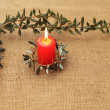 Stock Photo: Frame from lighting candle and branches of holly tree