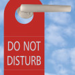 Do Not Disturb Tag On Handle Over Sky - Stock Photo
