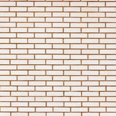 Beige colored fine brick wall texture background — Stock fotografie