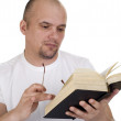 Stock Photo: The man reads the bible