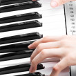 Artist hands of a piano player — Stock Photo