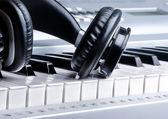 Headphones on keyboard — Stock Photo