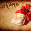Christmas stocking and bow — Stock Photo