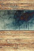ウッドの背景上の金属板 — ストック写真