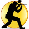 Black silhouette of the player in a paintball - Stock Vector