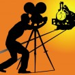 Silhouette of a cameraman filming a train - Stock Vector