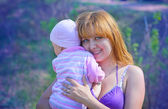 Mother and daughter outdoors in summer — Stock Photo
