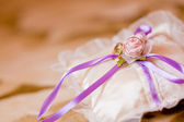 Wedding rings on a white satiny fabric — Stock Photo
