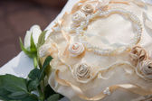 Pearl-beaded satiny fabric white rose — Stock Photo