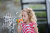 Young girl blowing bubbles. — Stock Photo