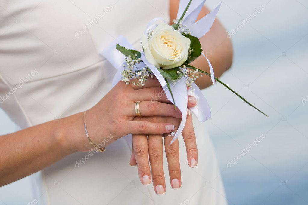 Bridal hands with wedding ring and flower — Photo #4750267