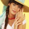 Girl in a straw hat — Stockfoto