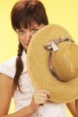 Girl with a straw hat — Stock Photo