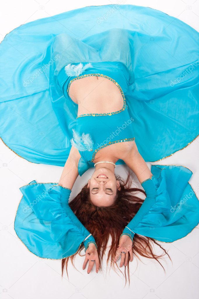 Belly Dancer in a blue stage costume — Stock Photo #4936460