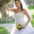 Portrait of beautiful bride with bouquet of roses — Stock Photo #5044350