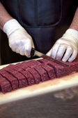 Slicing meat — Stock Photo
