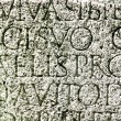 Roman letters carved in stone — Stock Photo
