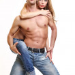 Picture of a sexy topless couple in studio — Stock Photo #4655228