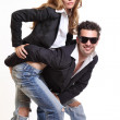Fashion couple posing in studio — Stock Photo
