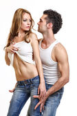 Sexy young couple on white background — Stock Photo