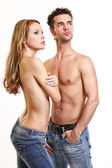 Sexy couple posing on white background — Stock Photo