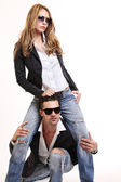 Young fashion couple posing in studio — Stock Photo