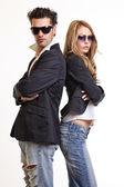 Fashion couple in studio — Stock Photo