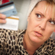 Stressed Woman Glaring At Her Many Credit Cards — Stock Photo #3930200