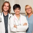 Three Smiling Male and Female Doctors or Nurses — Stock Photo #3930241