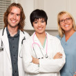 Stock Photo: Three Smiling Male and Female Doctors or Nurses