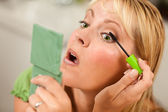 Blonde Woman Applying Her Mascara — Stock Photo