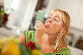 Woman Sticking Her Tongue Out at Herself in a Mirror — Stock Photo