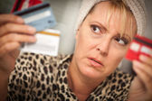 Stressed Woman Glaring At Her Many Credit Cards — Stock Photo