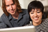 Happy Young Man and Woman Using Laptop Together — Stock Photo