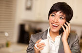 Multiethnic Woman with Coffee and Cell Phone — Stock Photo