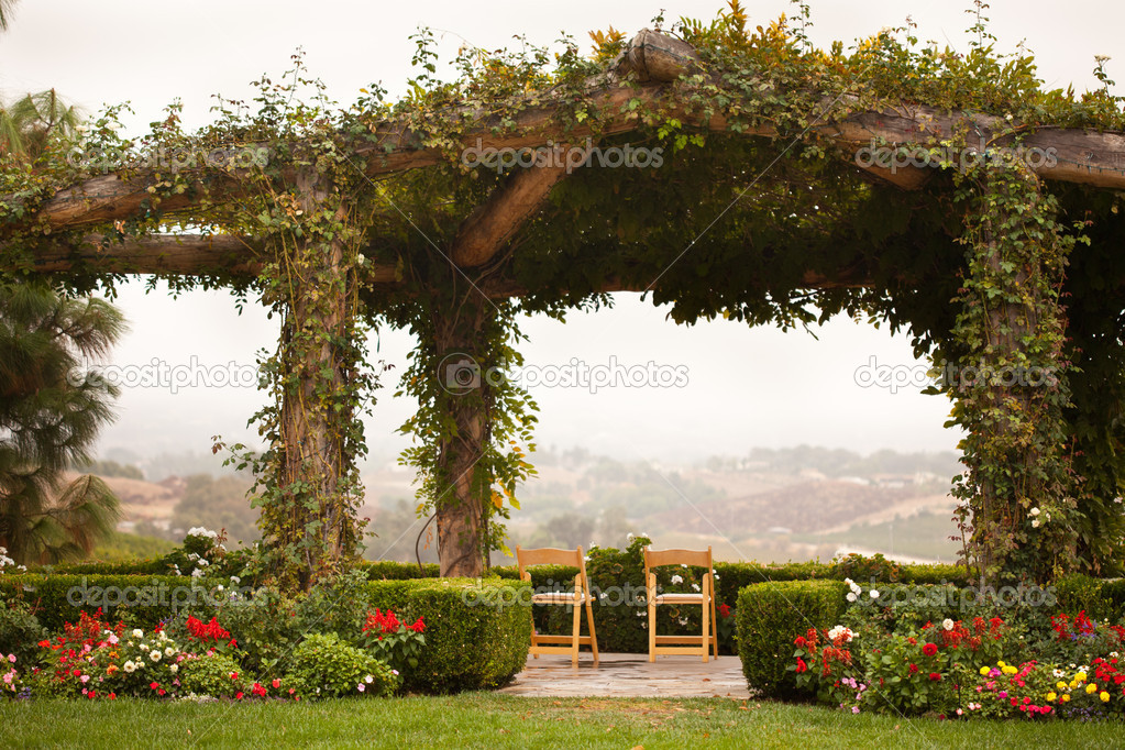 Beautiful Vine Covered Patio and Chairs with Country View. — Stock Photo #3962553