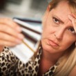 Upset Woman Glaring At Her Many Credit Cards — Stock fotografie