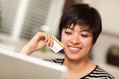 Smiling Multiethnic Woman Holding Credit Card Using Laptop — Stock Photo